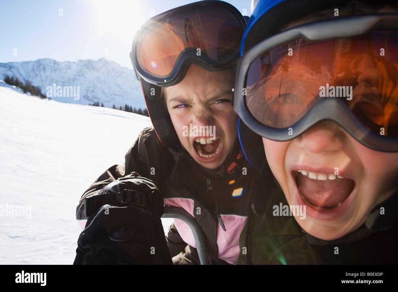 Children in ski helmets and goggles Stock Photo