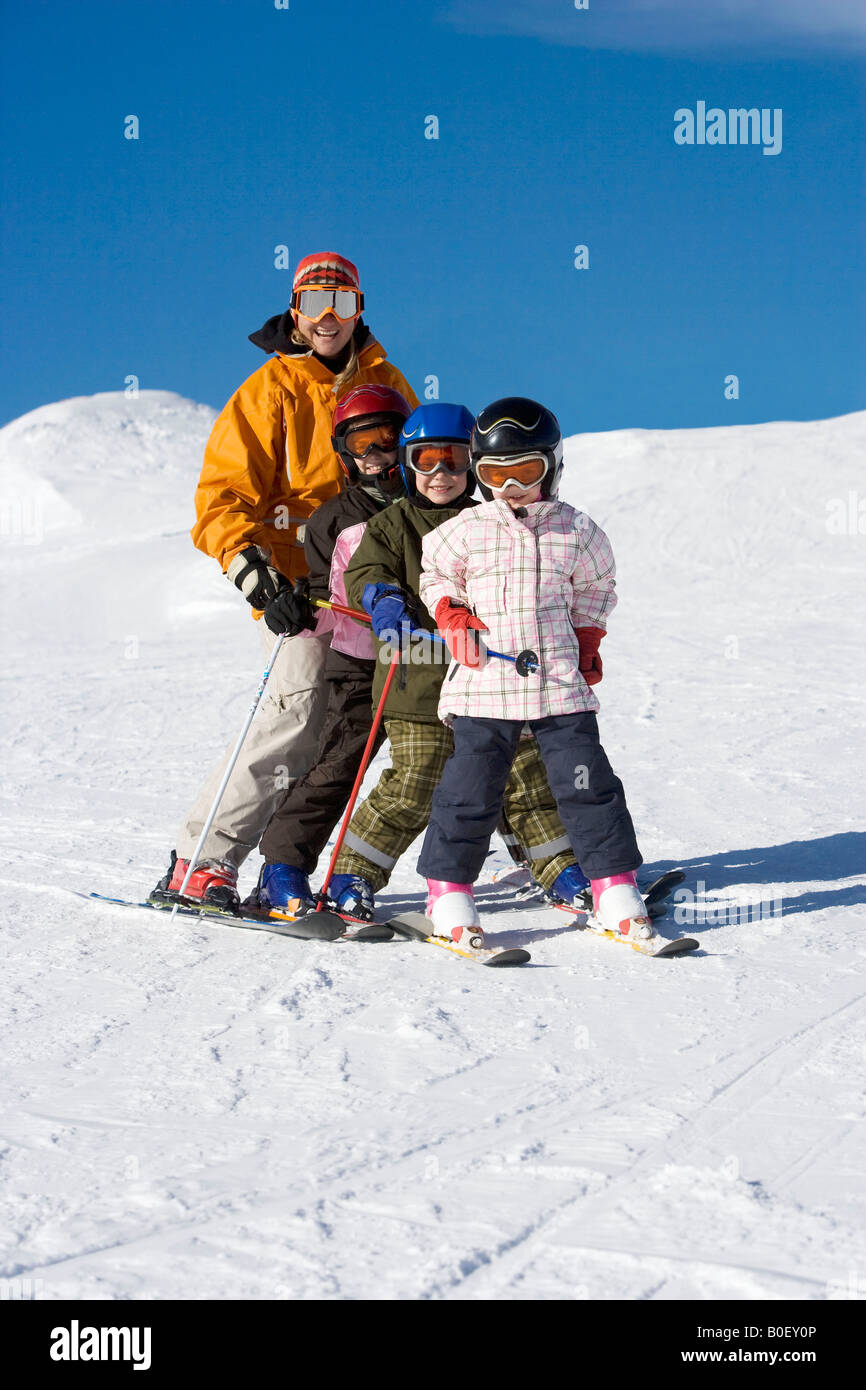 Mother skiing with children - Stock Image