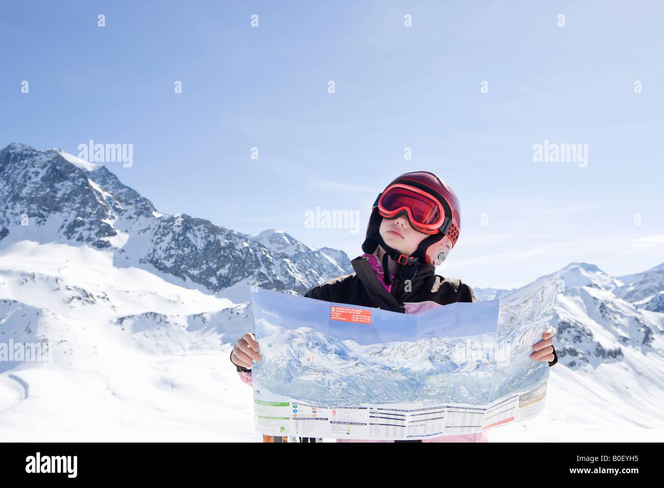 Girl Reading Piste map - Stock Image
