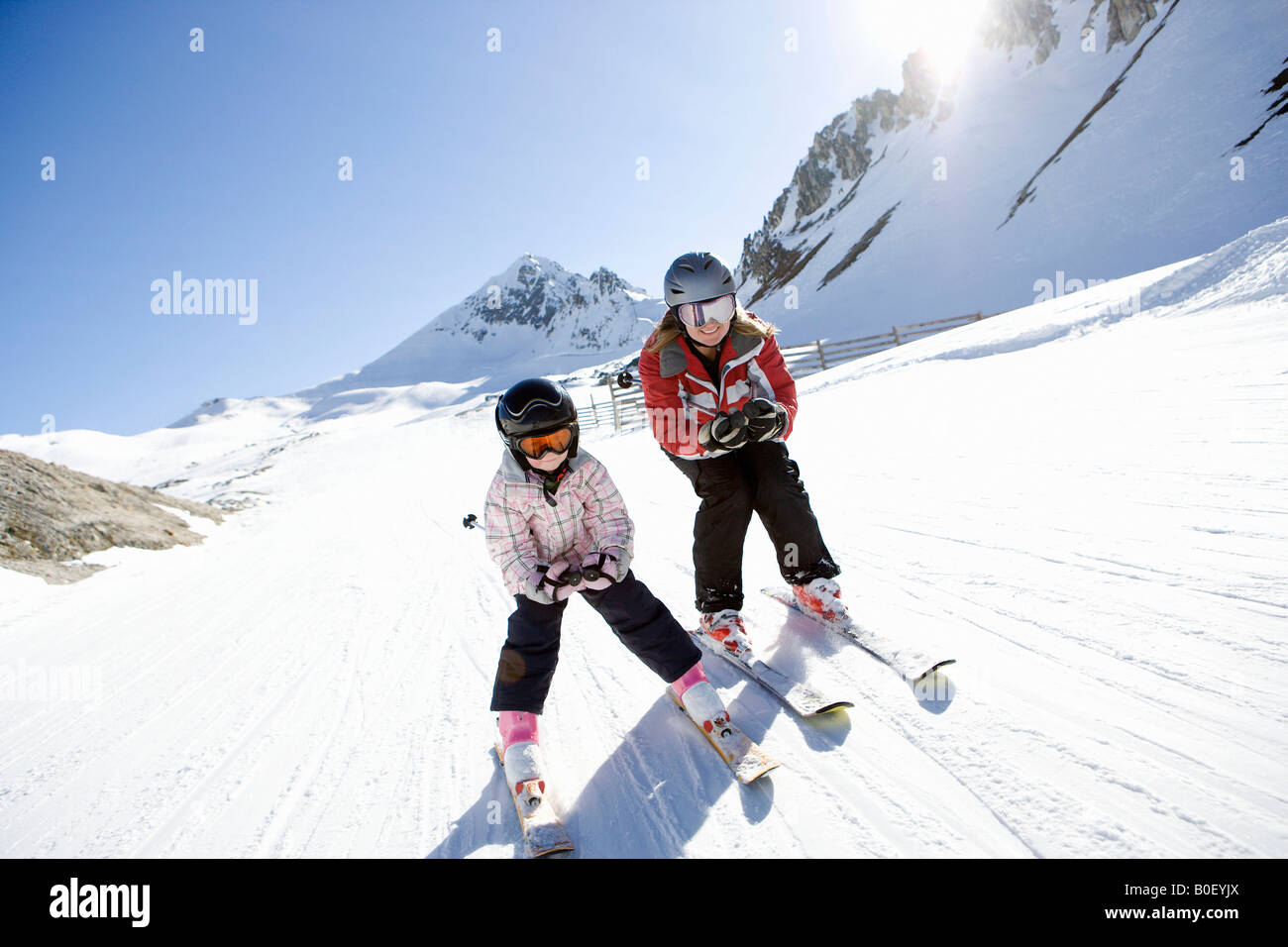 Mother and daughter skiing - Stock Image