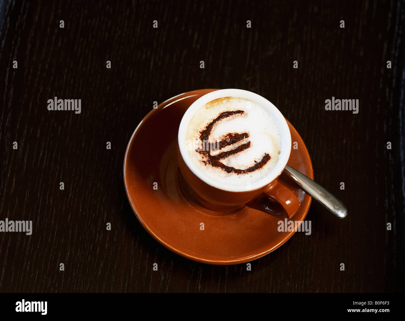 Cappuccino with 'euro' motif in cocoa - Stock Image