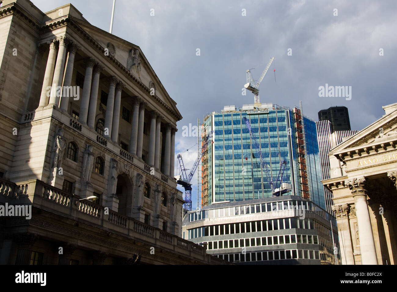 Construction work with cranes near The Bank of England London England United Kingdom - Stock Image
