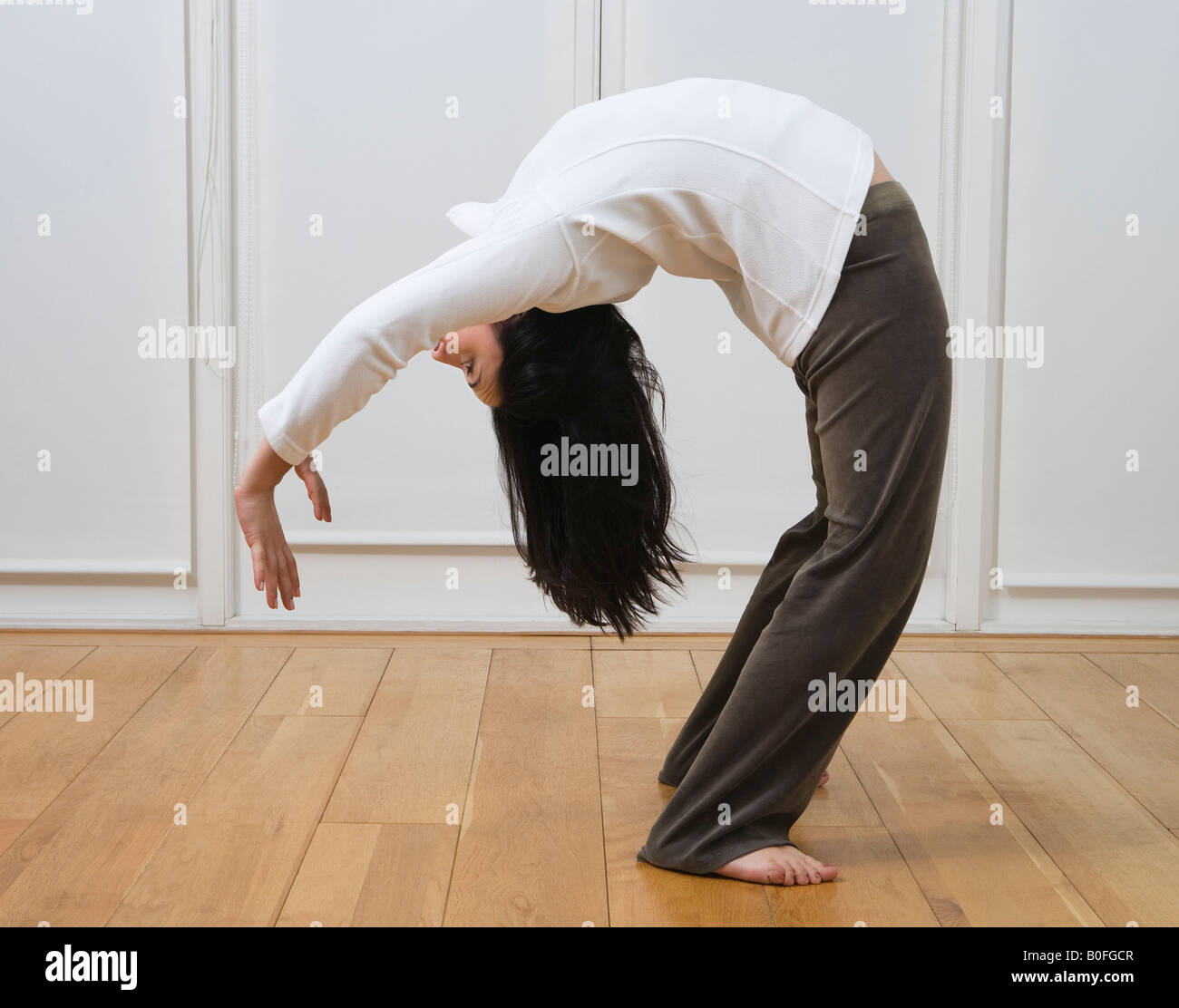 Woman doing back bend - Stock Image