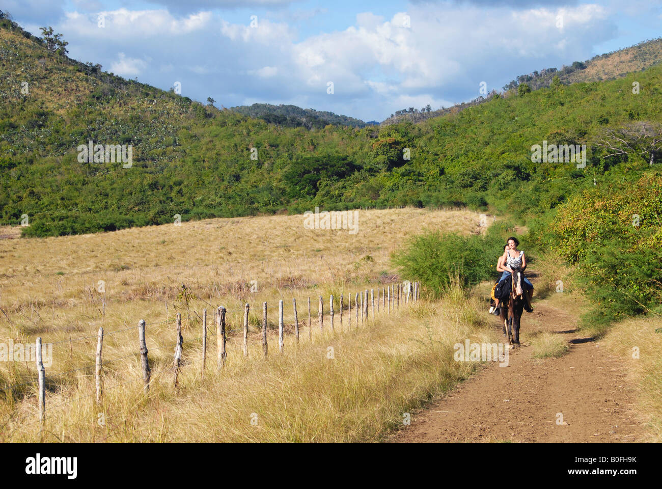 Female tourists on horseback Trinidad Cuba - Stock Image