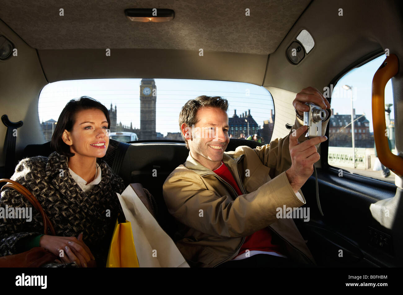 Couple in London taxi, Big Ben in view - Stock Image