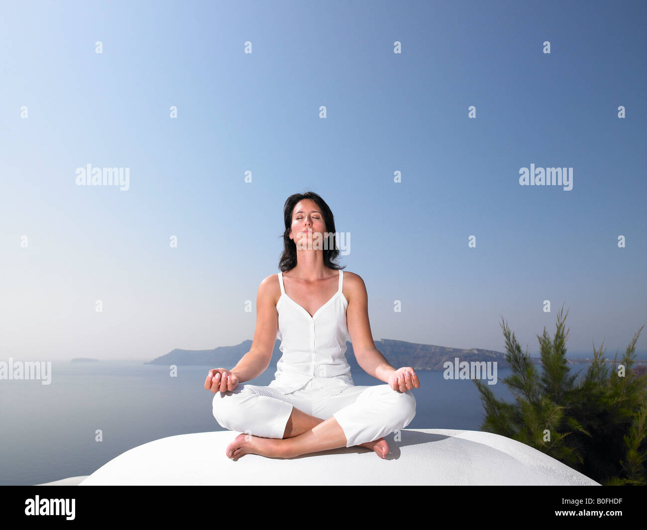 Woman in a yoga session - Stock Image