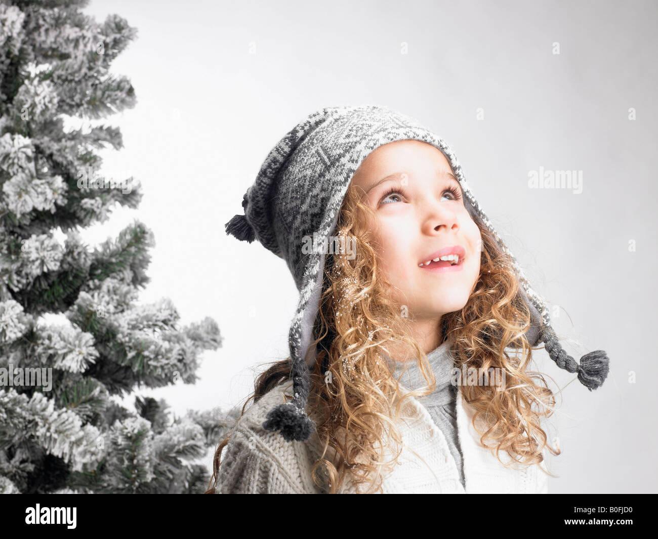 Little girl next to a fir-tree - Stock Image