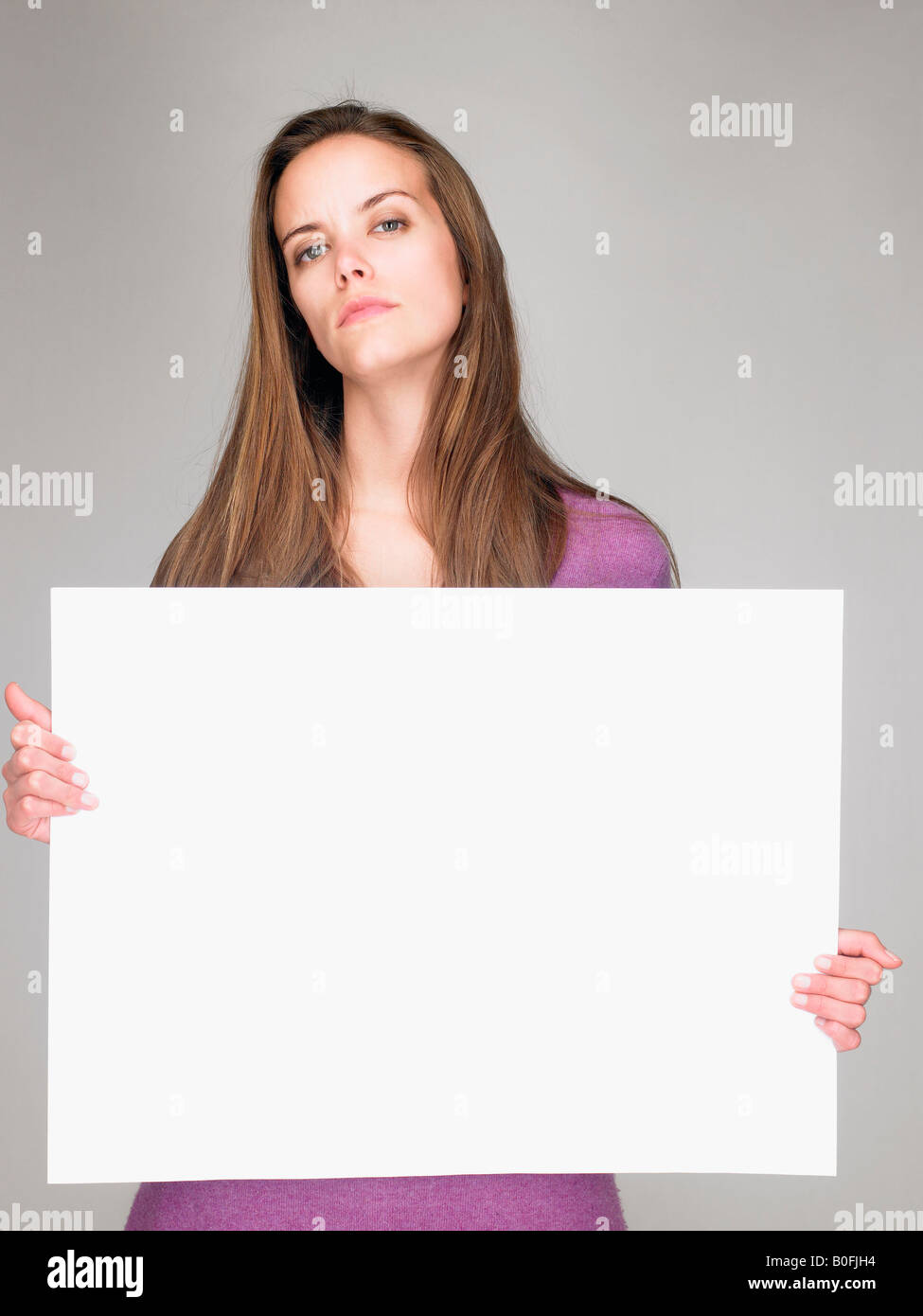 Woman carrying a notice, smiling - Stock Image