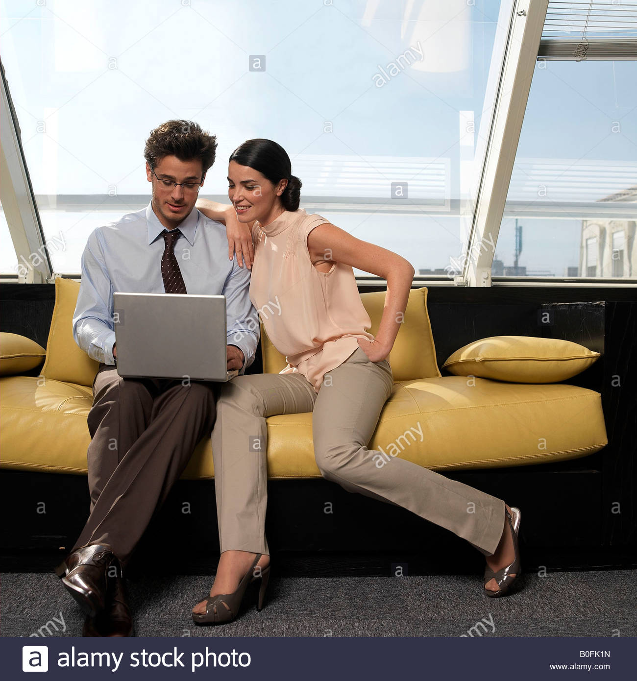 Couple looking at laptop - Stock Image