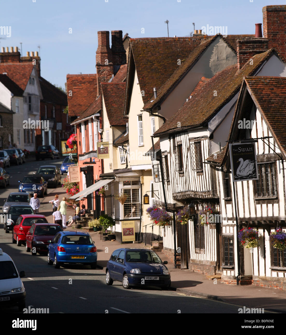 Lavenham Suffolk View up the High Street with Swan Hotel in the foreground Stock Photo