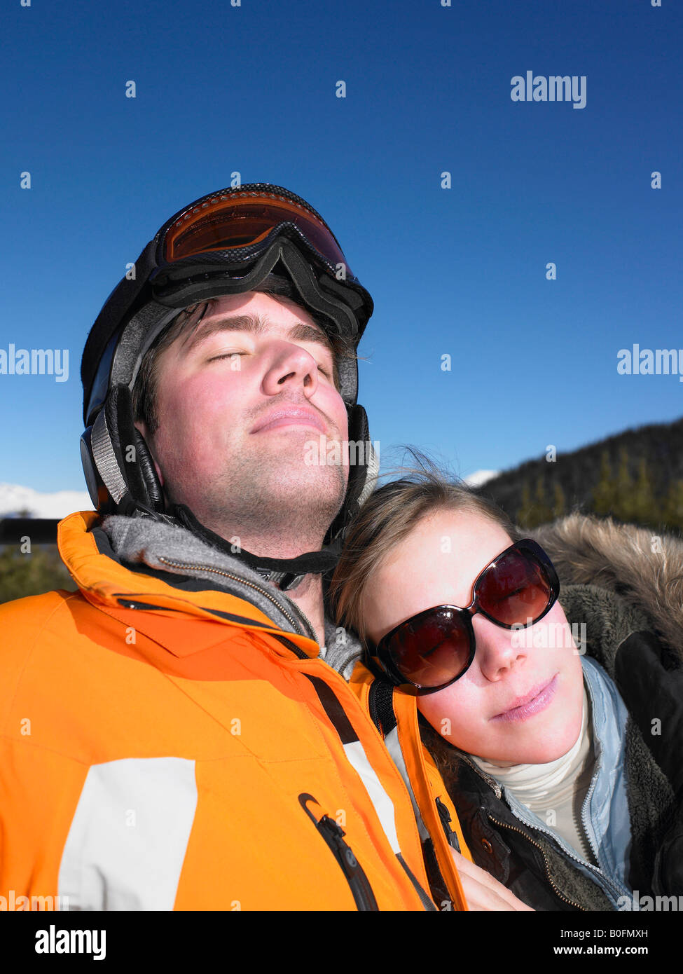 Couple on ski lift - Stock Image