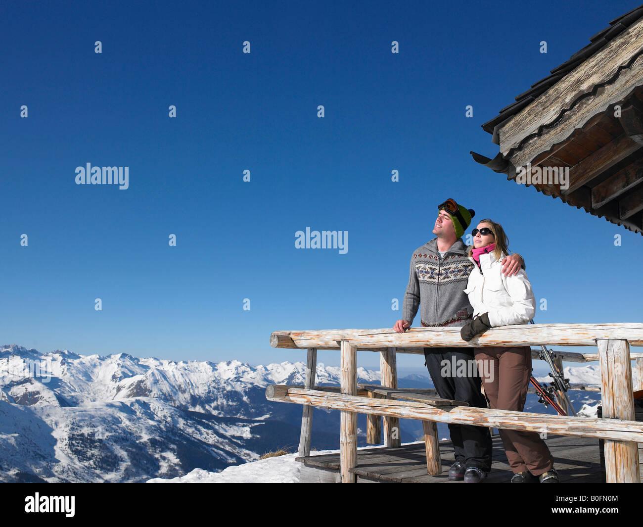 Couple enjoying sun at mountains Stock Photo