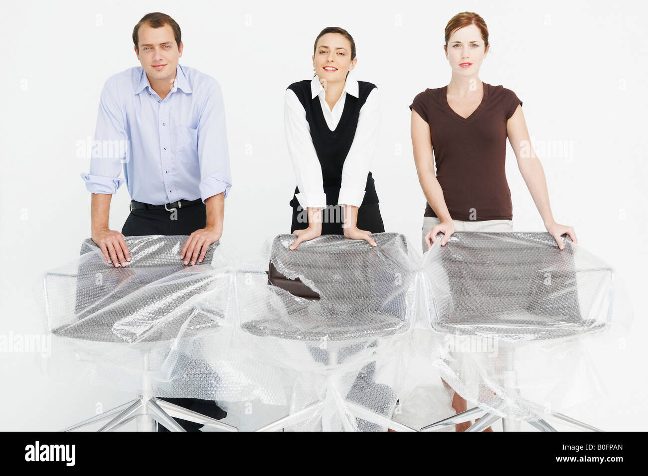 Three people in new office - Stock Image