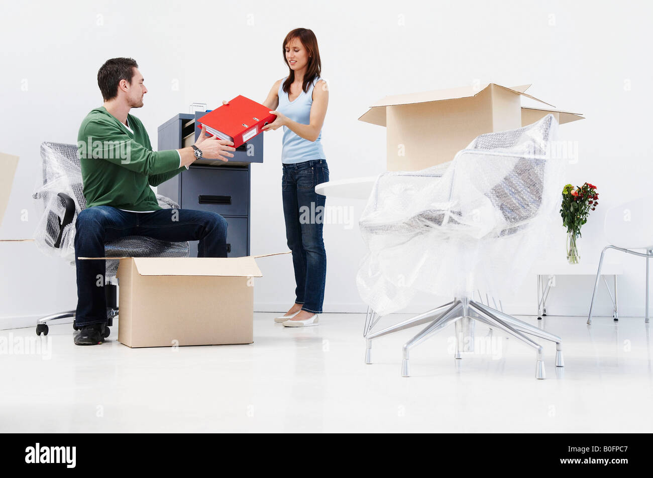 People setting up new office - Stock Image