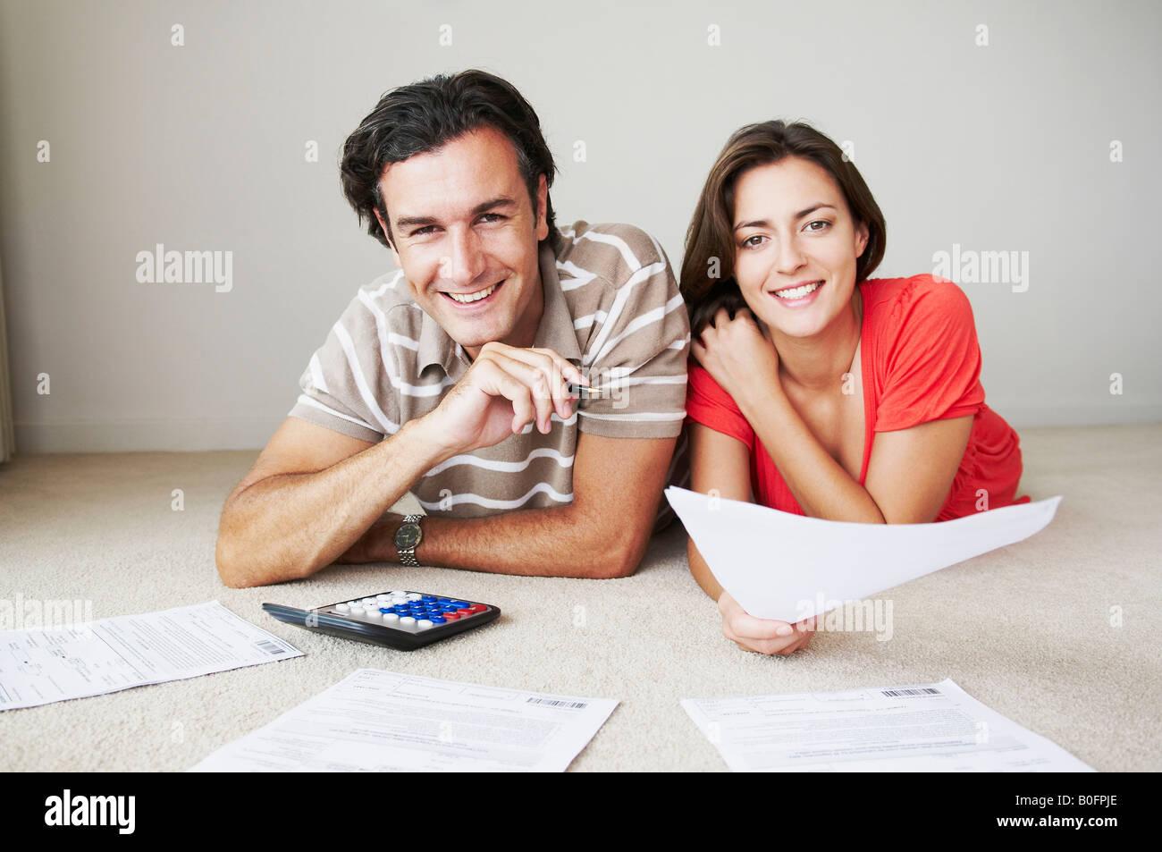 Couple work on home finance Stock Photo