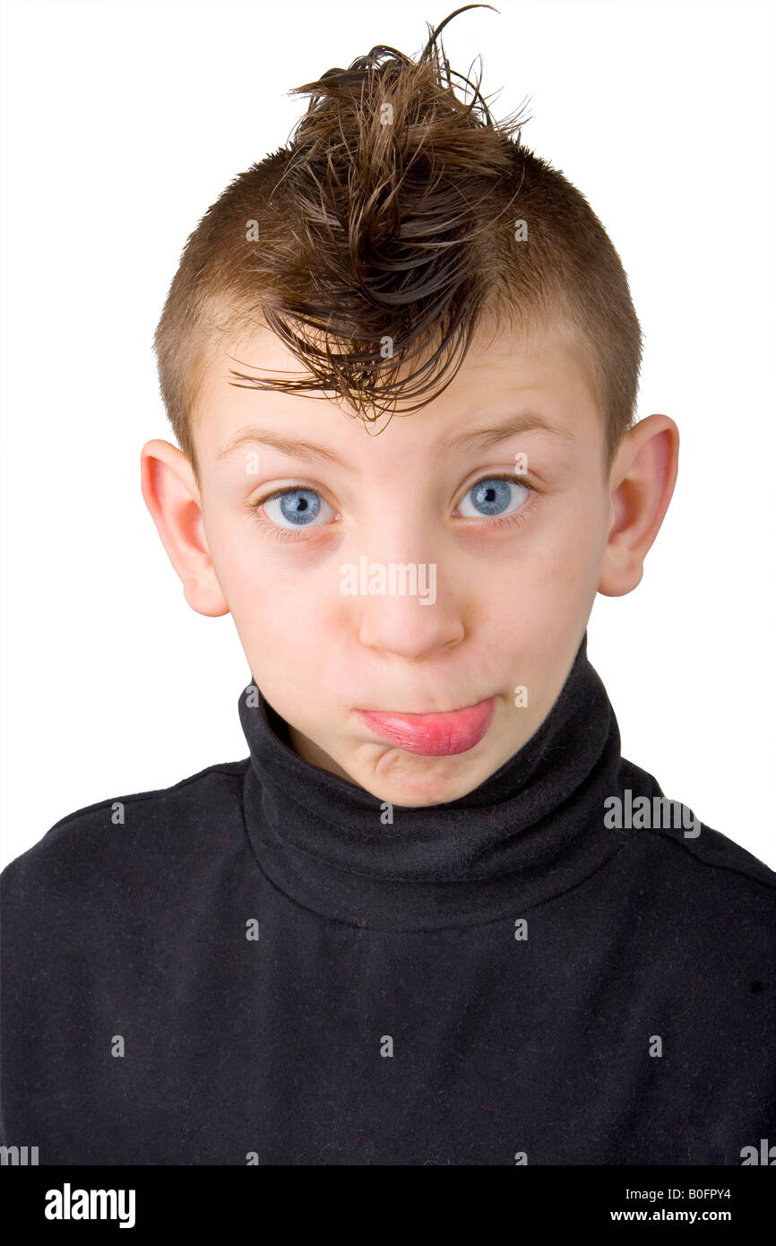 Portrait Of A Young Boy With Mohawk Hair Cut Making A Funny Face