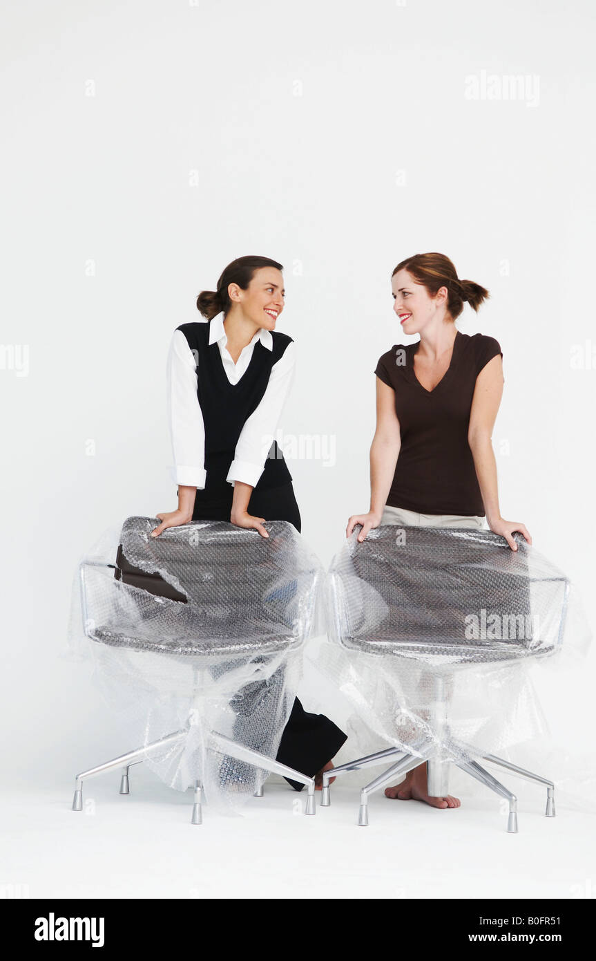Two women smiling in new office - Stock Image