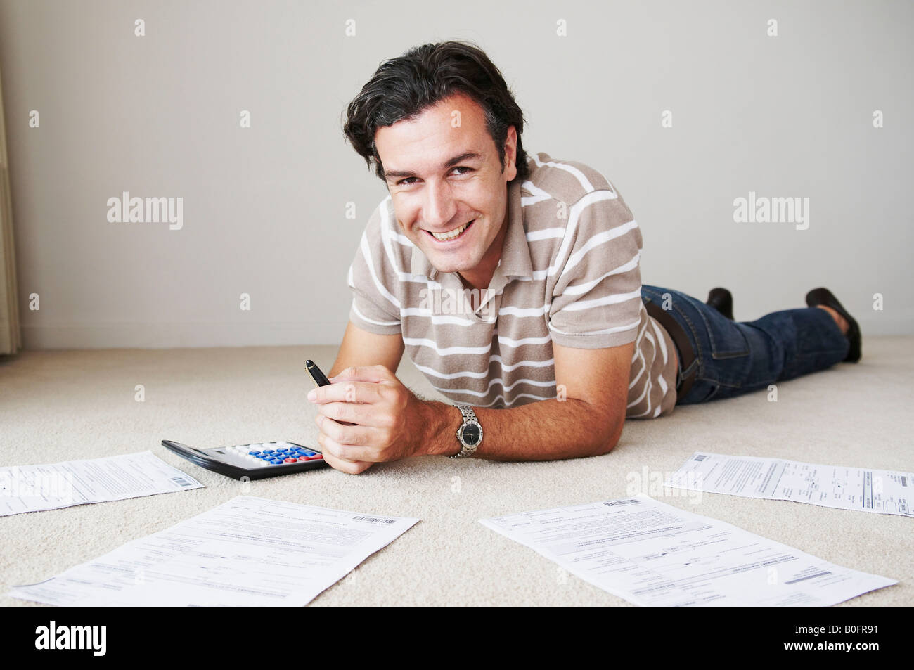Man works on home finance Stock Photo