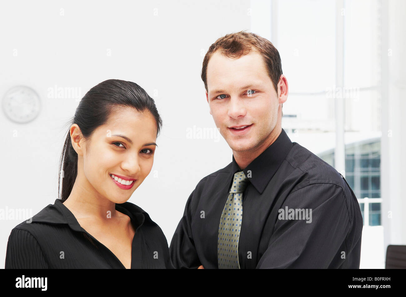 Two confident business people - Stock Image