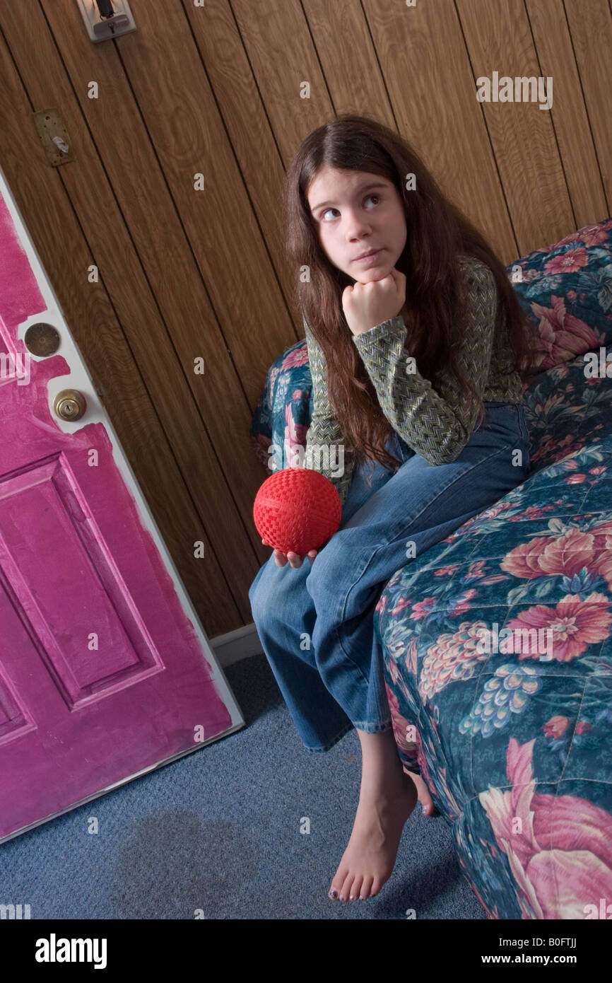 Pre Teenodel Pix: Preteen Girl Holding A Rubber Ball Sitting On A Bed In A
