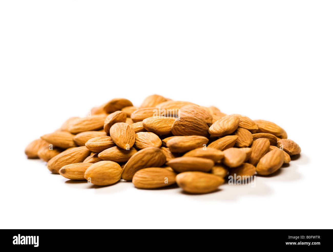 Pile of shelled Almonds, selective focus - Stock Image