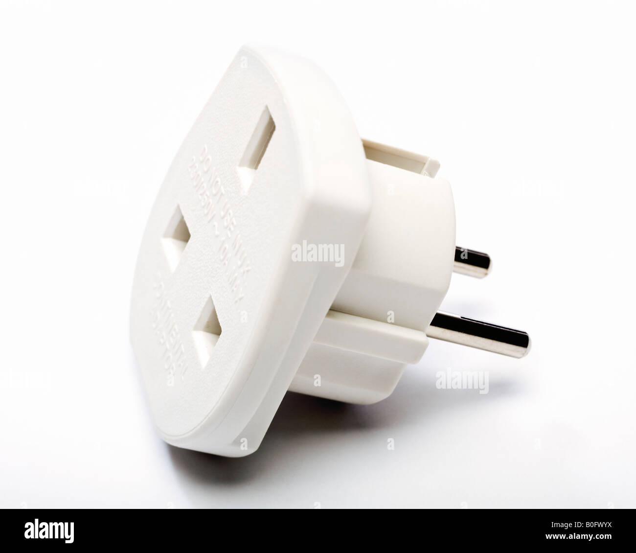 European plug adapter - UK 3 pin plug to European 2 pin plug travel adapter - Stock Image
