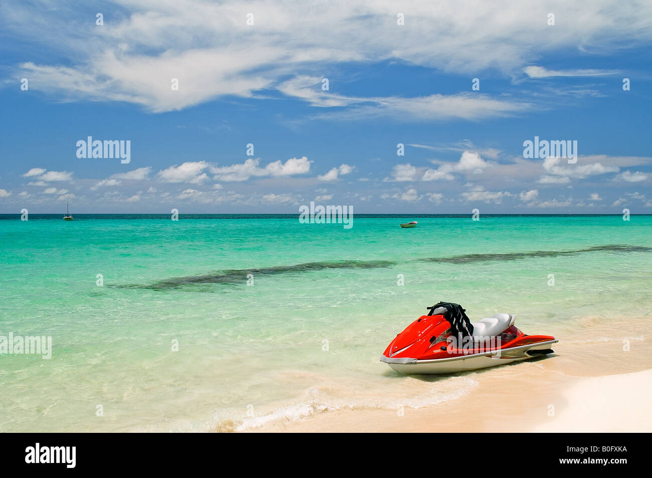 A personal watercraft floats in the water beckoning someone to get on for a ride. - Stock Image