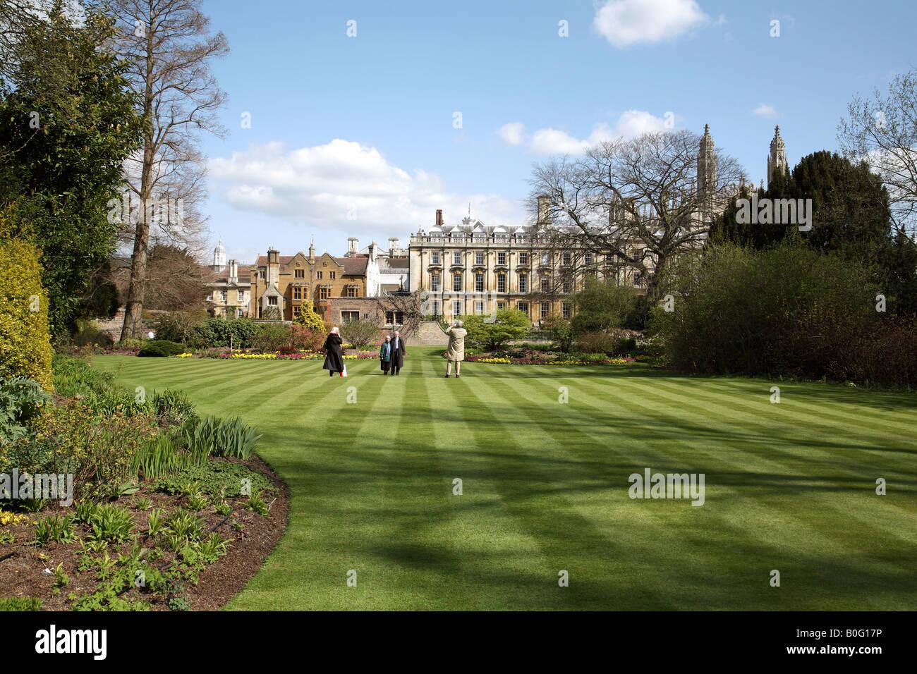 Tourists enjoy the Fellows Garden, Clare College, Cambridge on a fine spring morning - Stock Image
