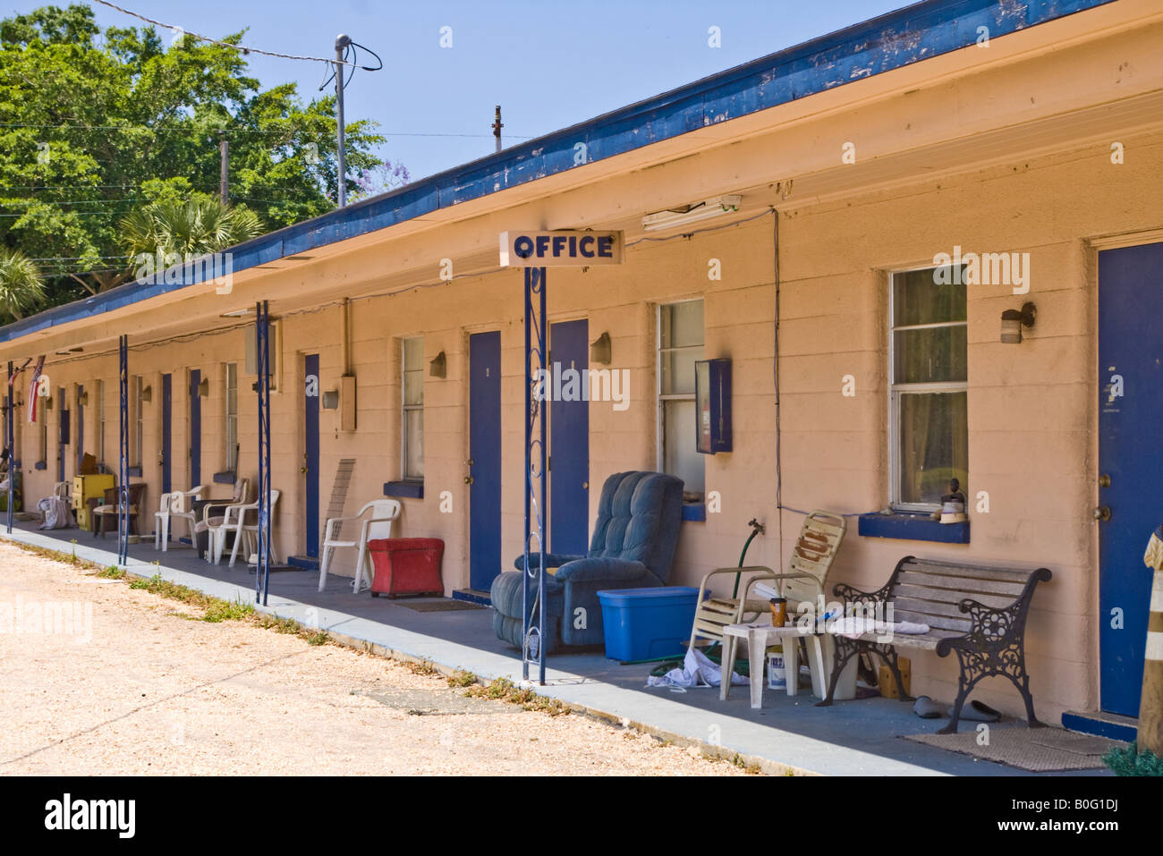 Old motel or travel lodge forced to convert to weekly rent apartment after the highway moved and business fell off - Stock Image