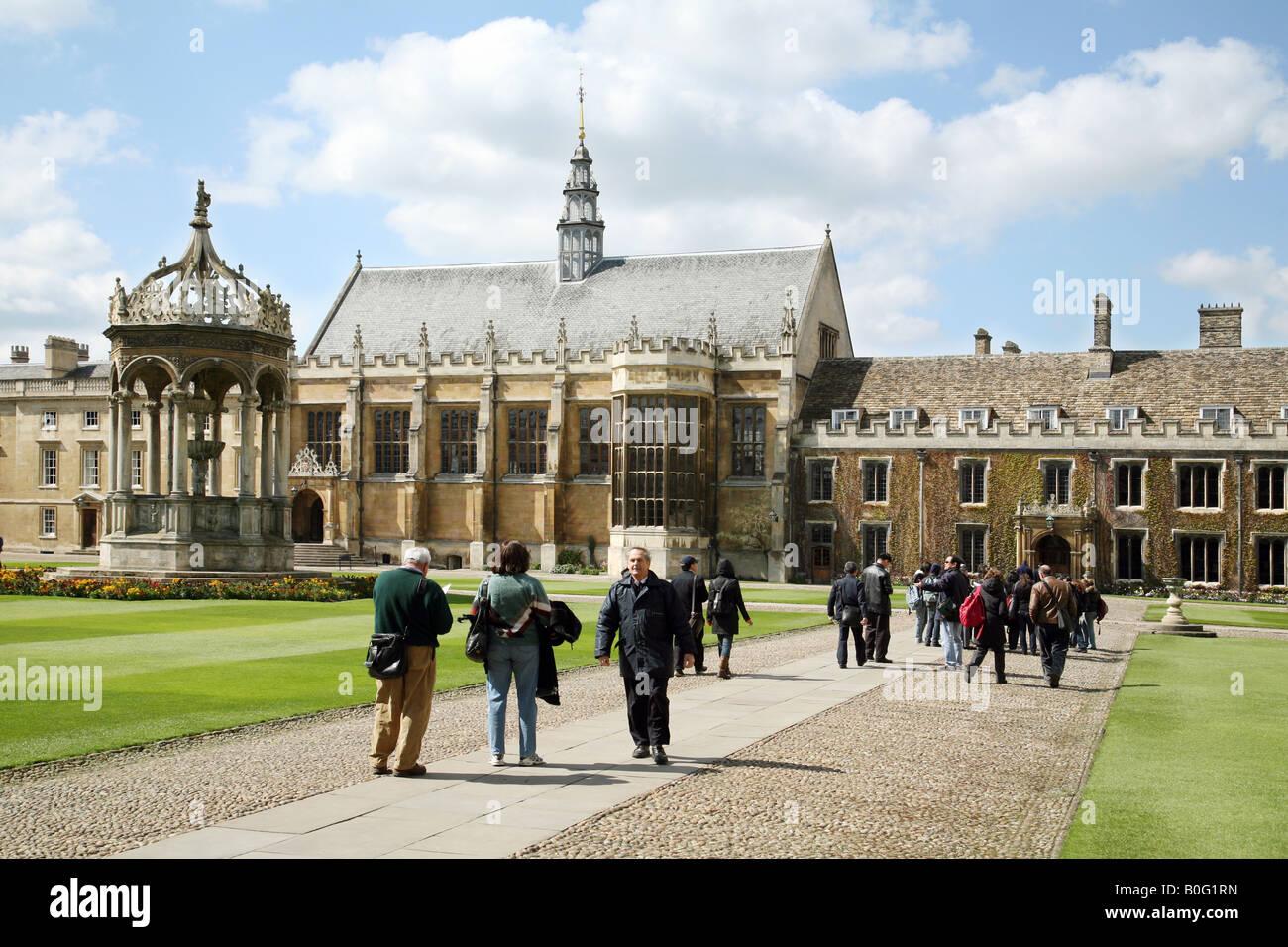 Cambridge University students and tourists in Great Court, Trinity College, Cambridge, UK - Stock Image