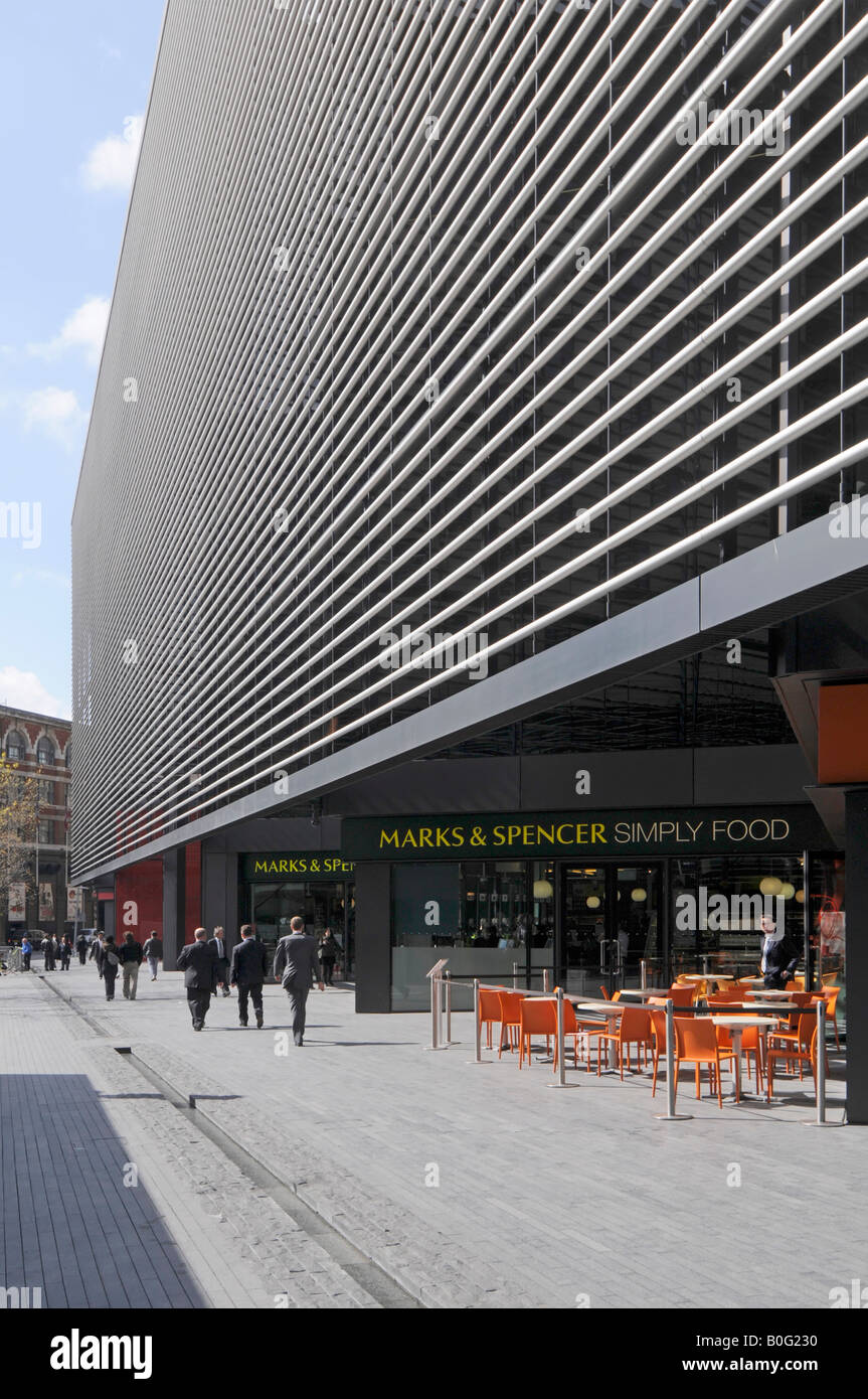 London Marks and Spencer Simply food store and pavement bar below modern office redevelopment - Stock Image