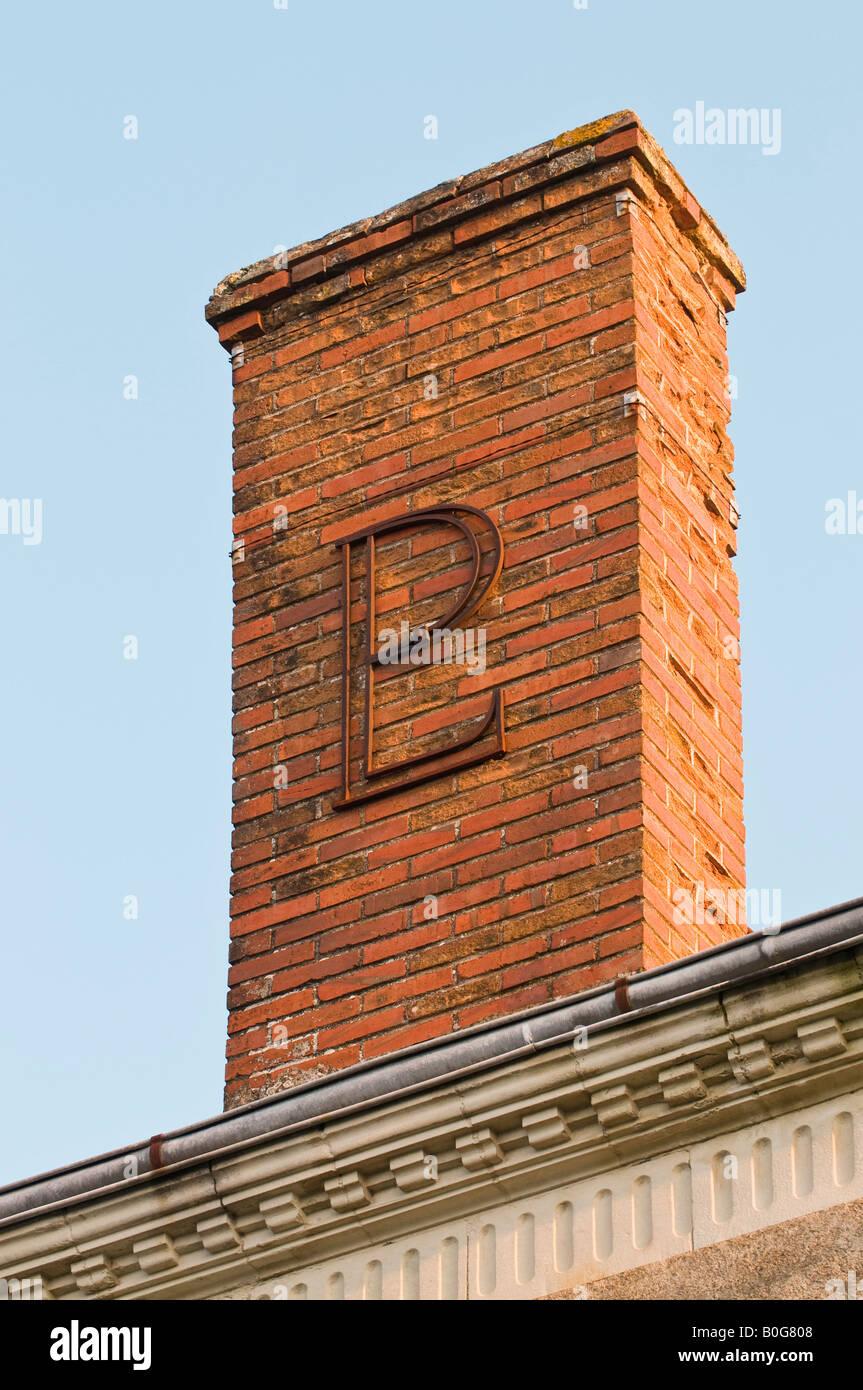 'PL' or 'LP' letters decorating chimney stack, France. - Stock Image