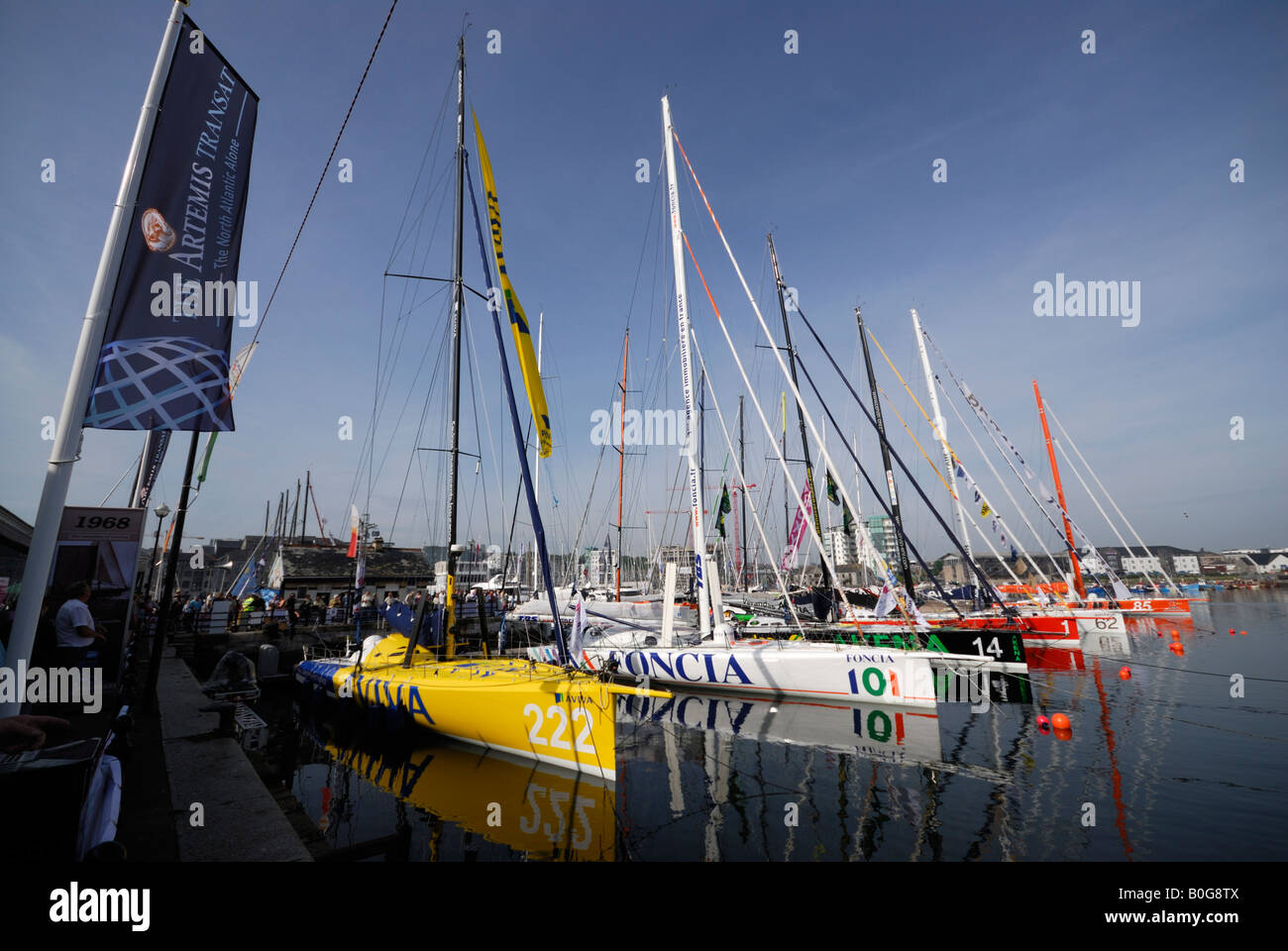 Yachts moored at the start of the Transat 2008 transatlantic yacht race in Plymouth, UK, with Transat flag flying Stock Photo
