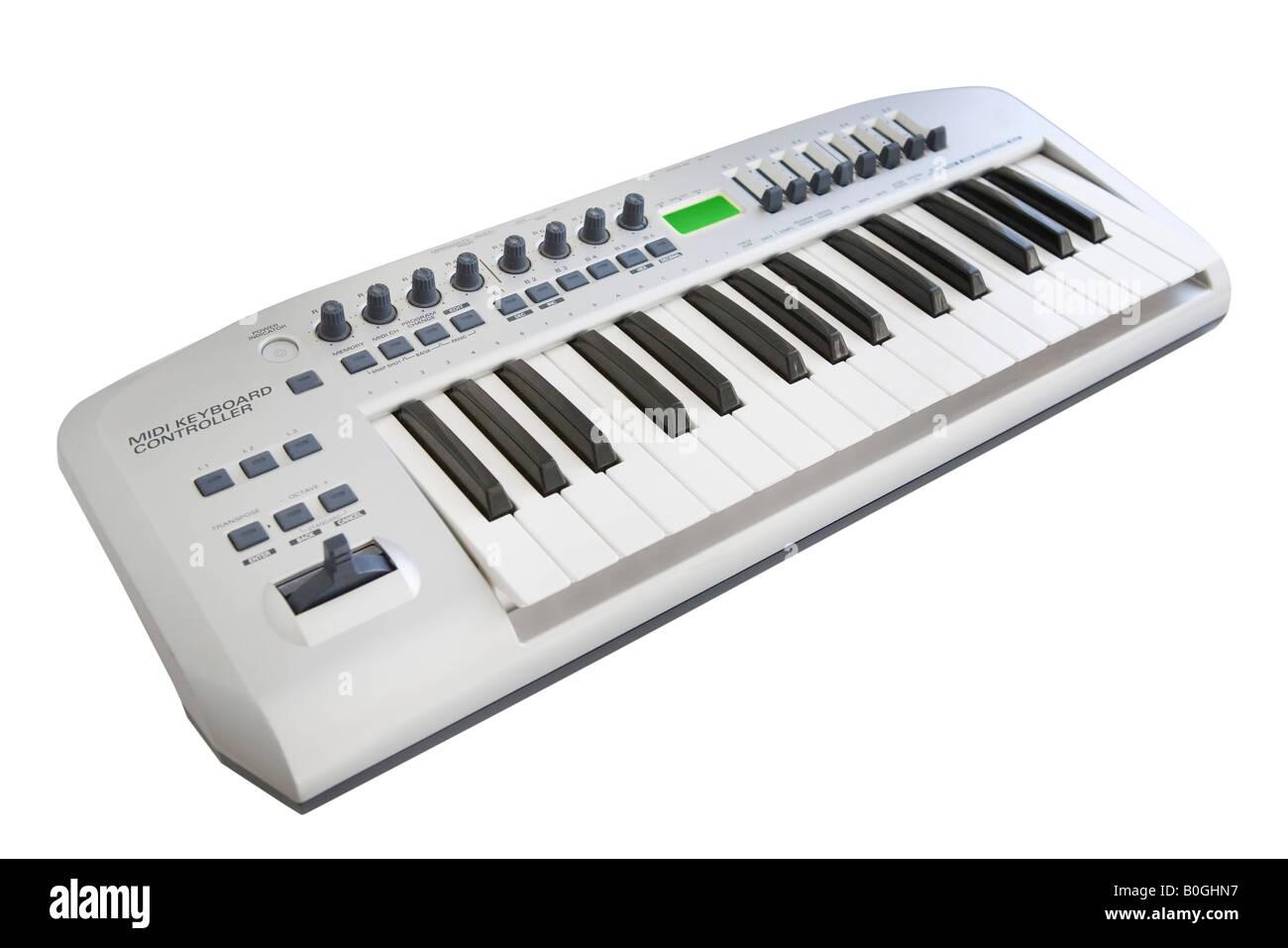 Electronic keyboard over white background - Stock Image