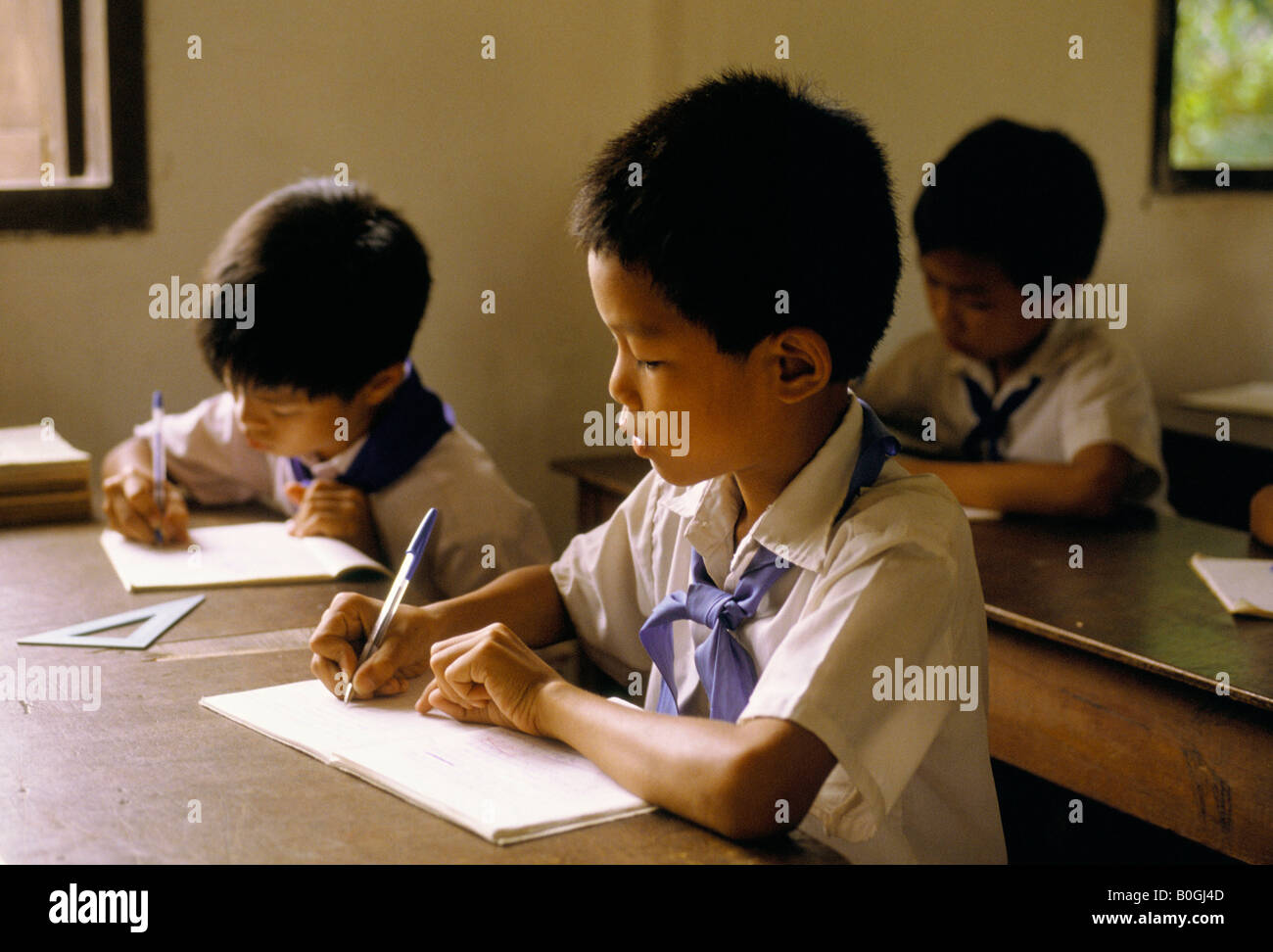 Boys writing in a primary school, Vientiane, Laos. Stock Photo