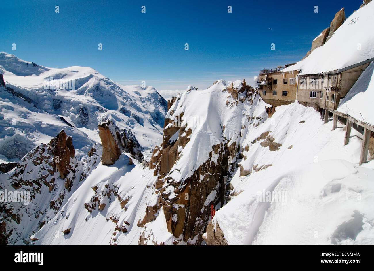 Aiguille du Midi cable-car top station and panoramic view platforms in winter with Mont Blanc massif in background, - Stock Image