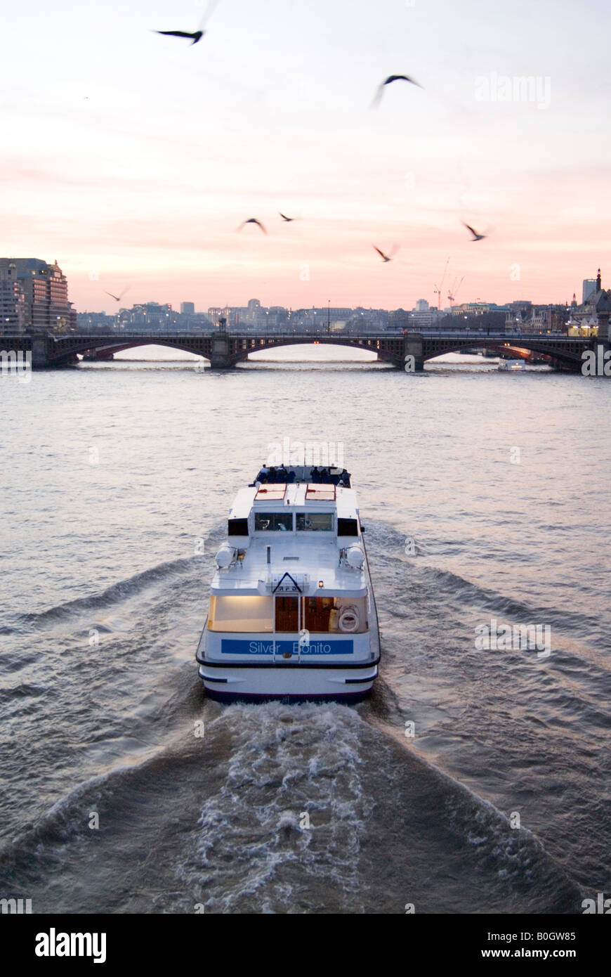 Boat trip on the river Thames at dusk London England UK - Stock Image