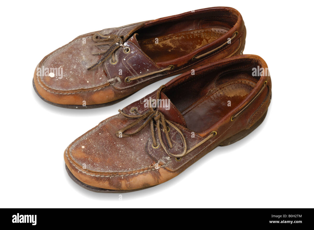 A pair of painter's shoes, worn out and spattered with paint - Stock Image
