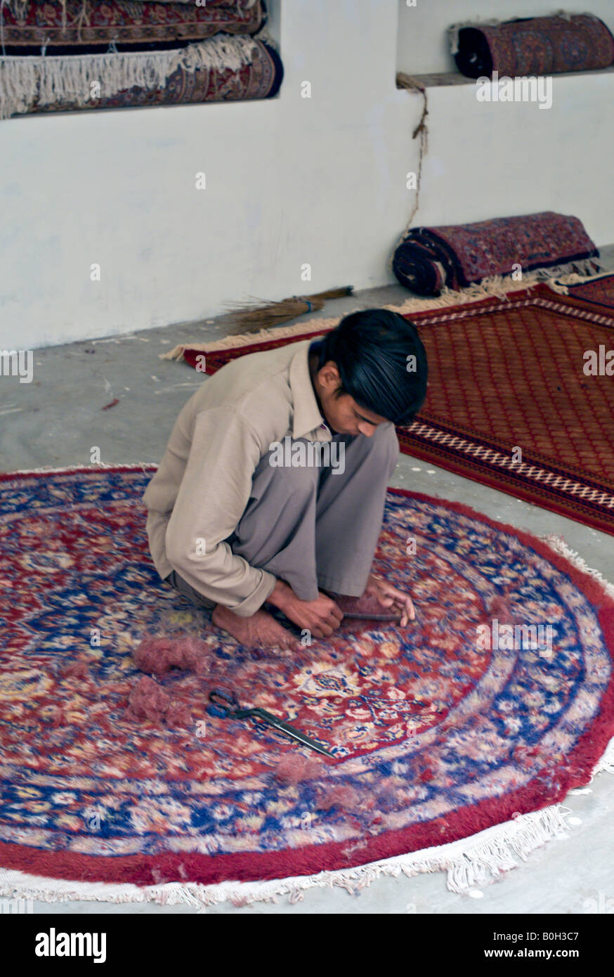 India Jaipur Young Indian Craftsman Trimming A Hand Knotted Rug In A