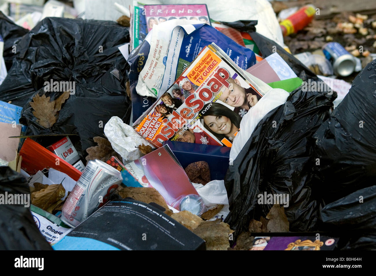 Illegally dumped house garbage in a woodland forest outside Medmenham in Buckinghamshire, England. Stock Photo
