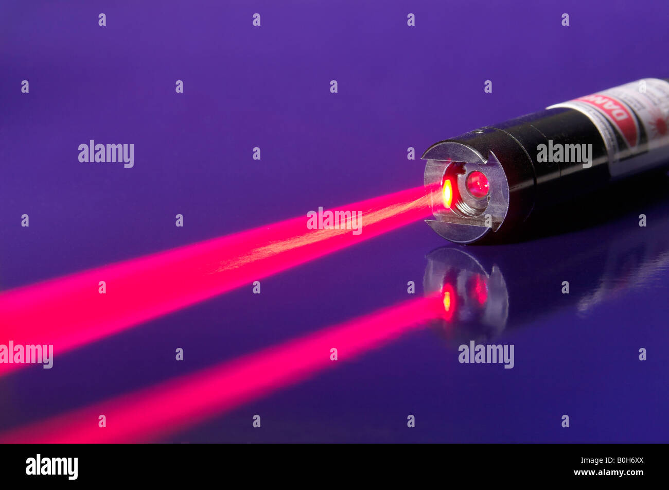 Red beam emitted by a laser - Stock Image