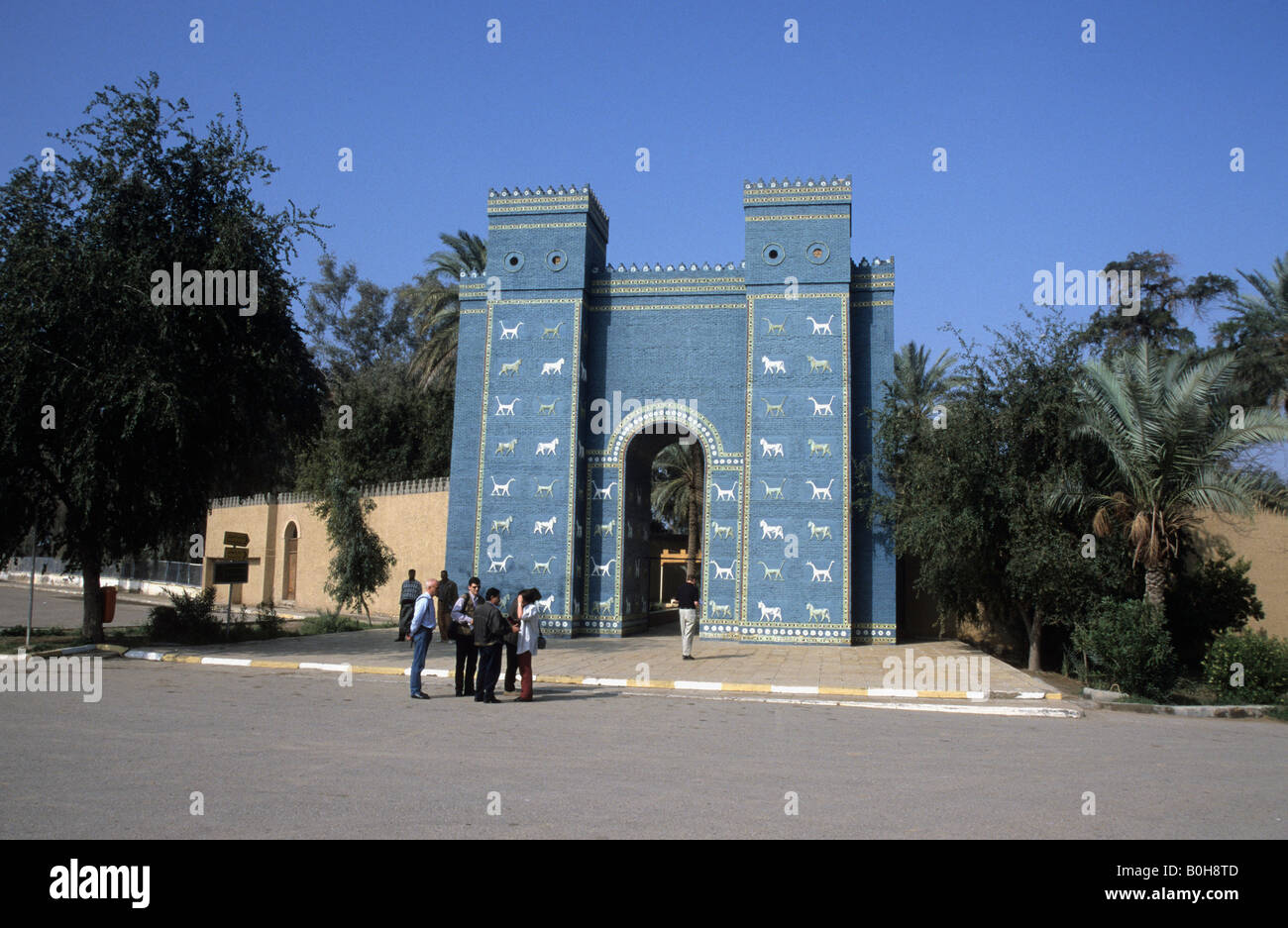 Tourists in front of the reconstructed Ishtar Gate, Babylon, Iraq, Middle East Stock Photo