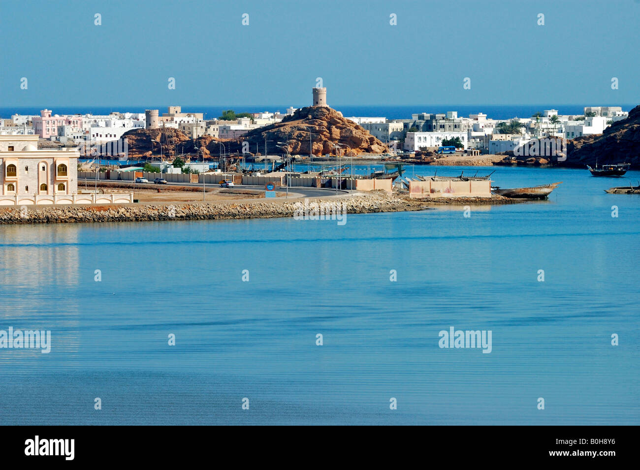 Two watchtowers built on rocky hills overlooking the harbour of Sur, Oman, Middle East Stock Photo