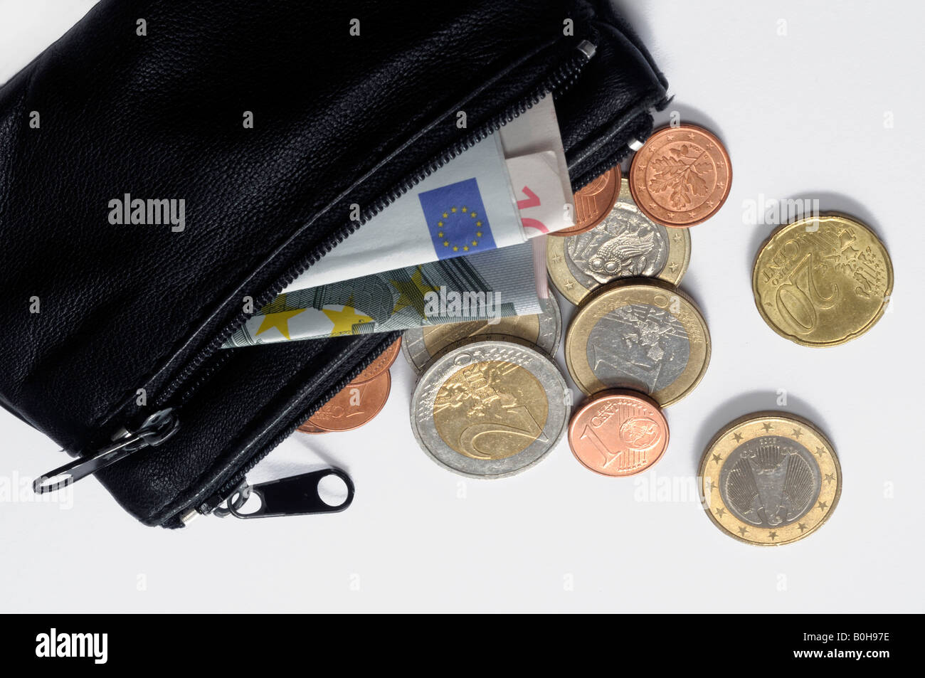 Black wallet with Euro coins and banknotes, bills, cash - Stock Image