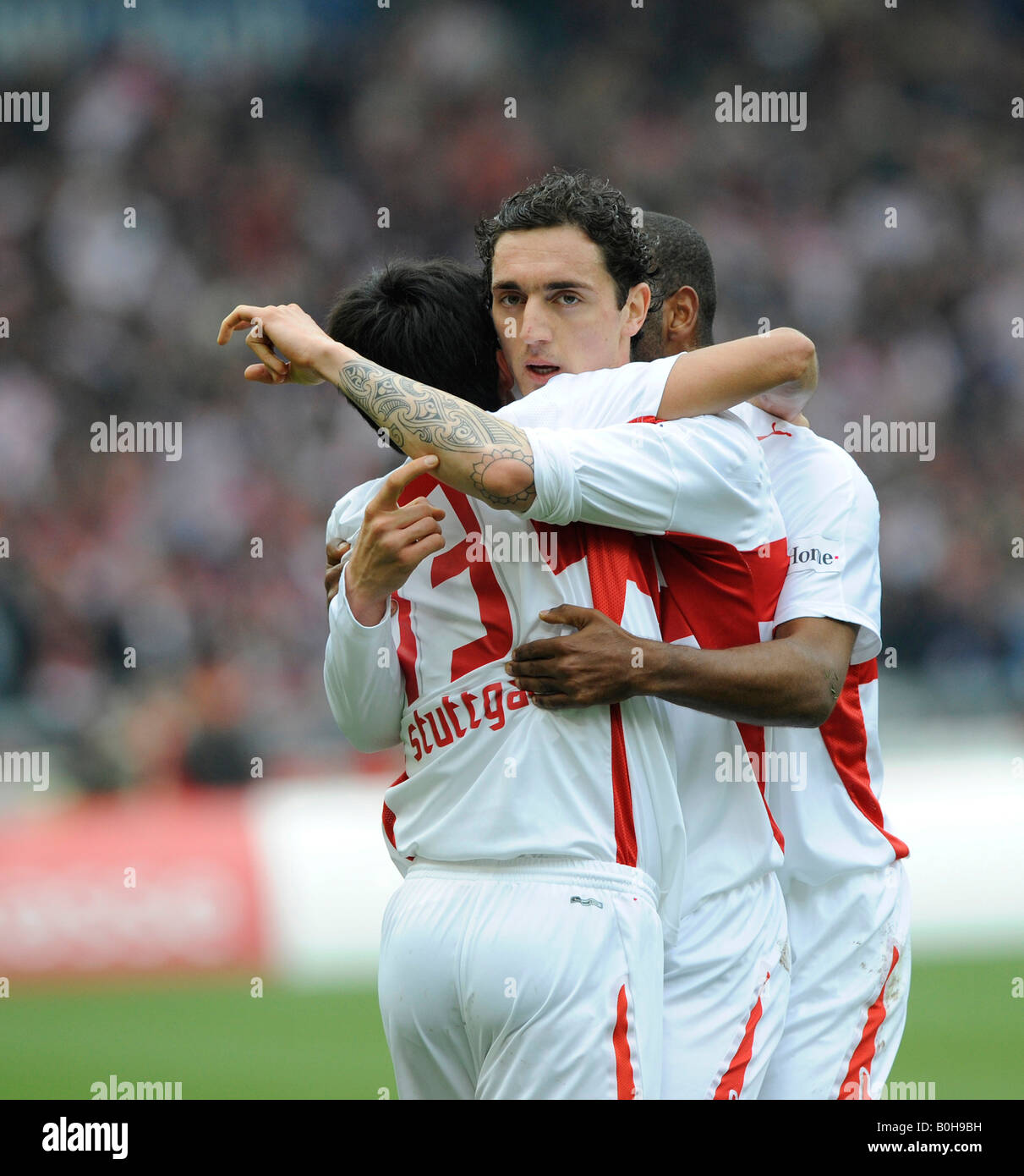 VfB Stuttgart football club players celebrating a goal, left to right: Pavel Pardo, Roberto Hilbert, Cacau and Yildiray - Stock Image