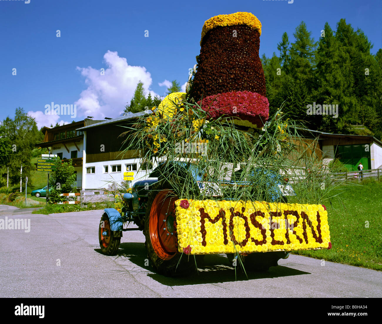 Parade float made of flowers, participant from Moesern, flower parade in Seefeld, Tirol, Austria - Stock Image