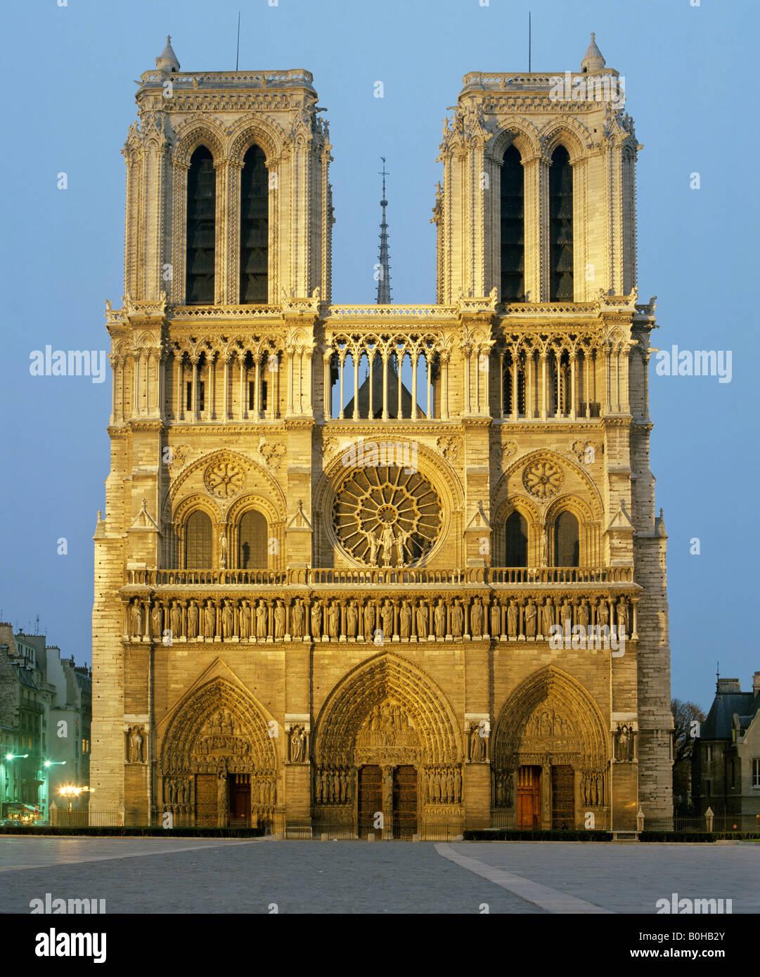Notre Dame de Paris at dusk, west facade, gothic cathedral, Paris, France - Stock Image