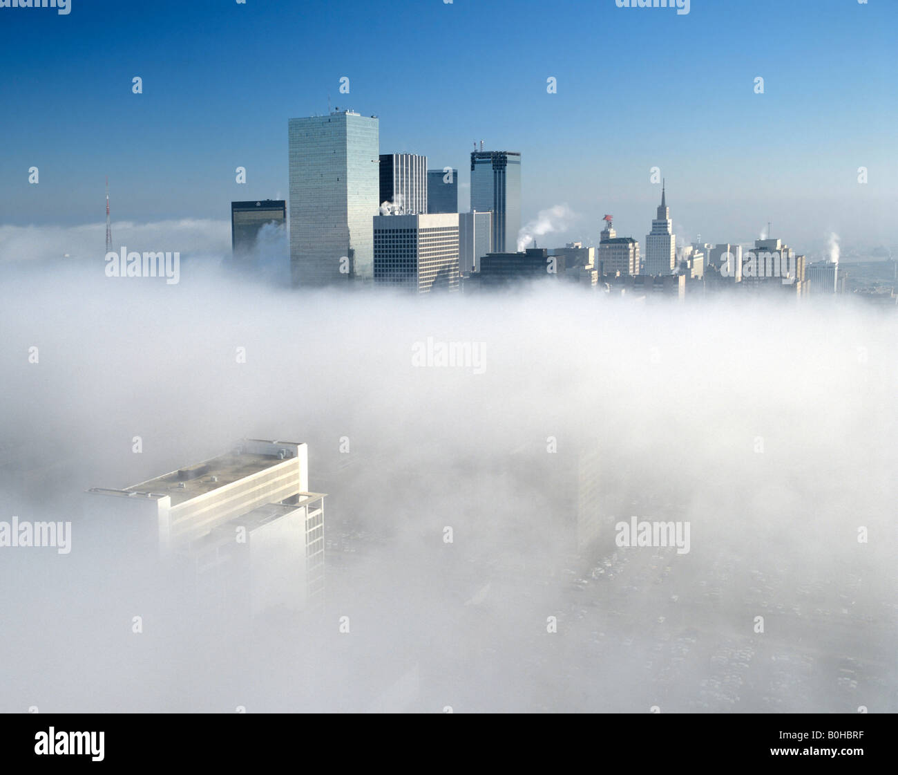 Dallas skyline in the fog, Dallas, Texas, USA - Stock Image