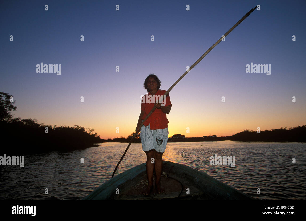 Woman standing on the bow of a vessel crossing the lagoon to Mexcaltitan Island, Nayarit, Mexico - Stock Image