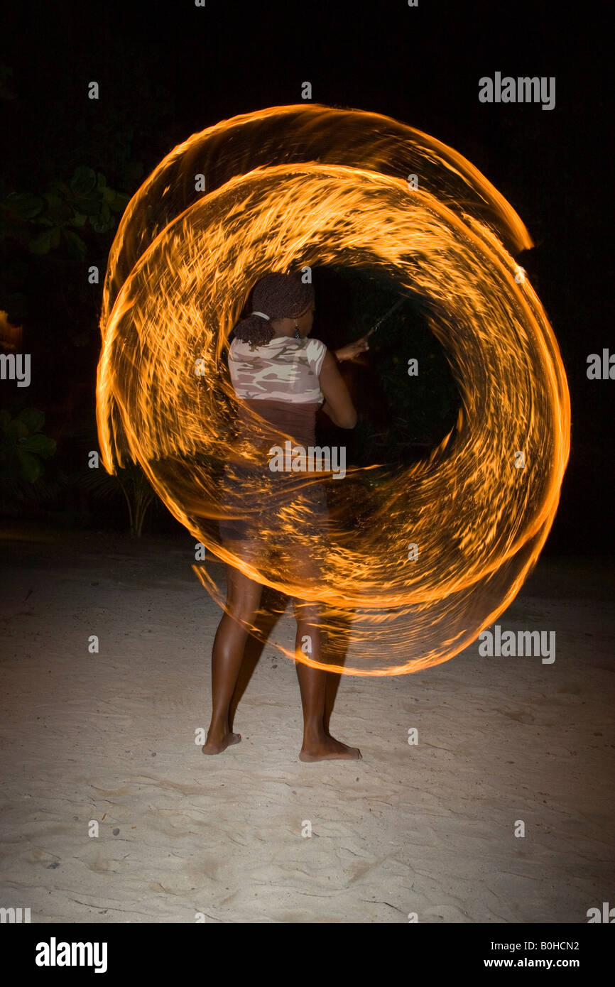 Fire artist performing at an evening event held for tourists in Honduras, Central America - Stock Image